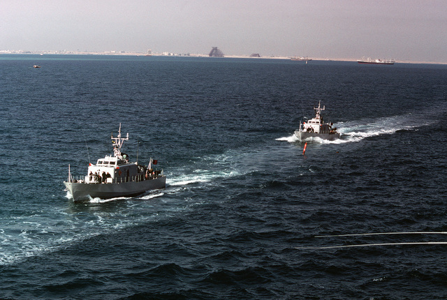A port bow view of two Qatarian large patrol craft underway