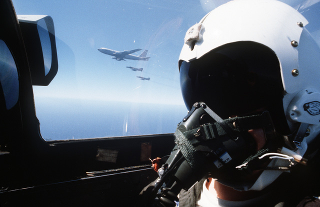 A view from the cockpit of a 199th Tactical Fighter Squadron, Hawaii Air National Guard, F-4 Phantom II aircraft as two other F-4s form up near a 161st Air Refueling Group KC-135 Stratotanker aircraft for aerial refueling
