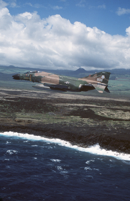 An air to air left side view of a 199th Tactical Fighter Squadron, Hawaii Air National Guard, F-4 Phantom II aircraft