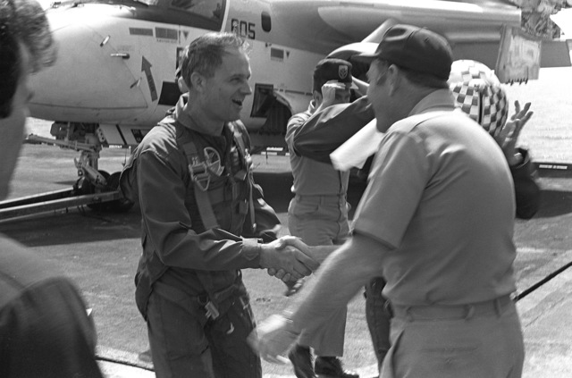 Captain Thomas C. Watson Jr., right, commanding officer, welcomes Rear Adm. Frederick C. Johnson for a visit aboard the aircraft carrier USS INDEPENDENCE (CV-62)