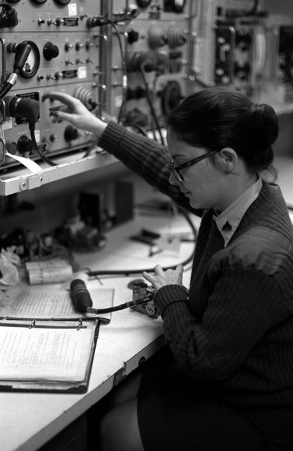 Woman Marine CPL. Snith performs one of her many jobs as an avionics electronic technician