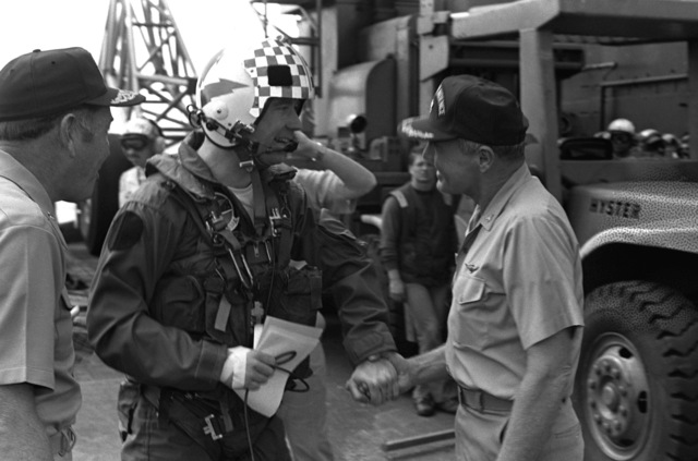 CAPT Thomas C. Watson Jr., right, commanding officer, welcomes Charles Snodgrass, a distinguished guest arriving for a visit aboard the aircraft carrier USS INDEPENDENCE (CV-62)