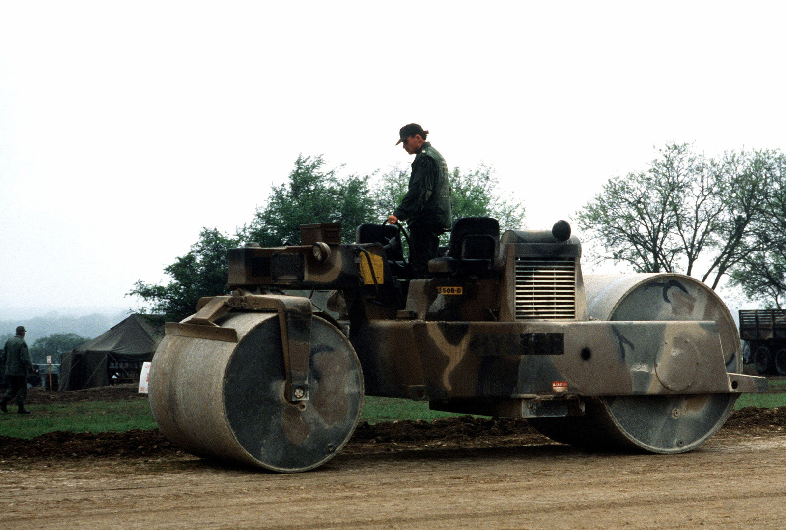 A member of the 62nd Engineer Battalion, 13th Corps Support Command, III Corps operates a motorized roller to upgrade an airfield during joint Air Force and US Readiness Command training exercise Brave Shield XIX