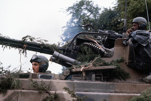 Army personnel man an M-163 20mm Vulcan self-propelled anti-aircraft gun during joint Air Force and U.S. Readiness Command training exercise Brave Shield XIX