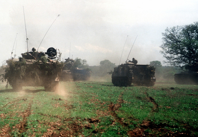 Tanks and armored personnel carries maneuver the joint Air Force and US Readiness Command training exercise Brave Shield XIX