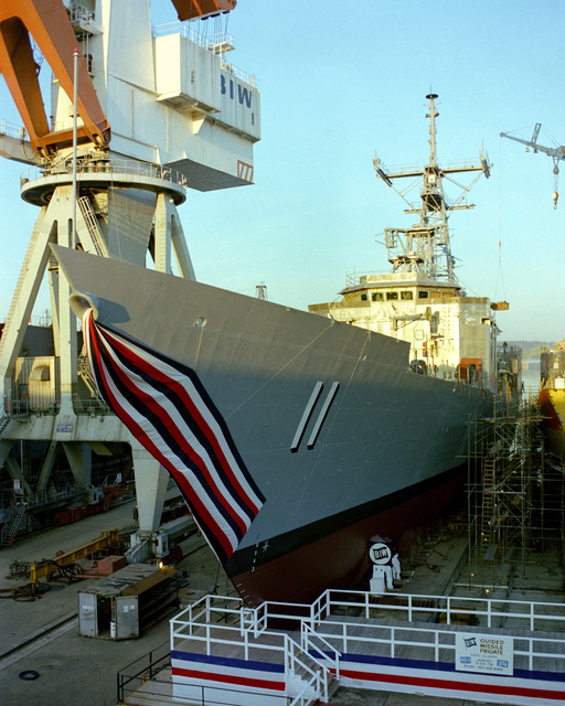 A port bow view of the guided missile frigate CLARK (FFG-11) on the ways during its launching ceremony at Bath Iron Works