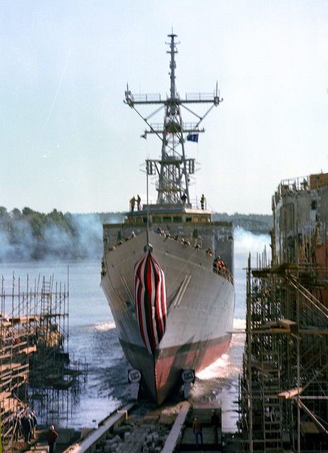 A port bow view of the guided missile frigate CLARK (FFG-11) sliding down the ways during its launching ceremony at Bath Iron Works