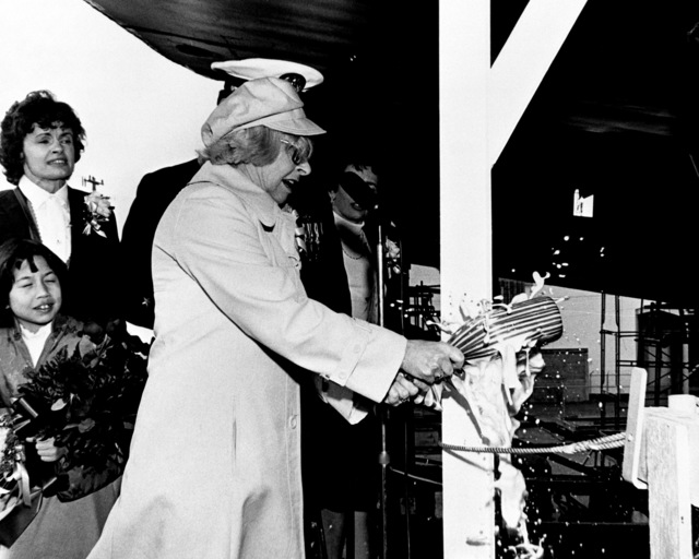 Mrs. Richard Antrim, sponsor, christens the guided missile frigate ANTRIM (FFG-20) during its launching ceremony at Todd Pacific Shipyards Corporation