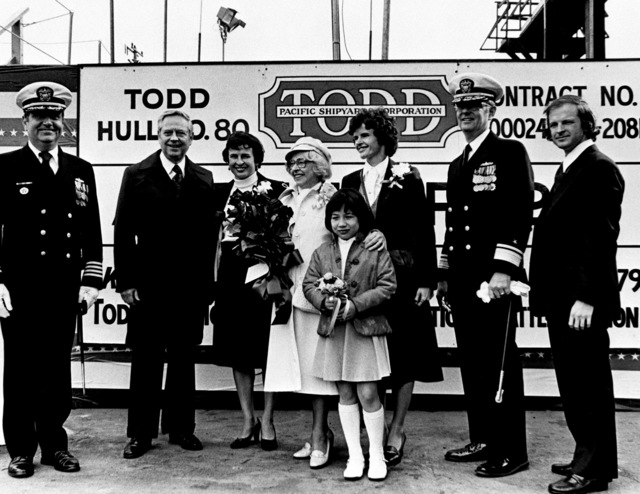 The launching party for the guided missile frigate ANTRIM (FFG-20) are from left to right: CAPT S. P. Passantino, Mrs. Carl R. Meurk, Mrs. Leonard Laylon, Mrs, Richard N. Antrim, Miss No Robertson, Mrs. William Walker, RADM Floyd H. Miller and Mr. Lance Antrim during the ship's launching ceremony at Todd Pacific Shipyards Corporation