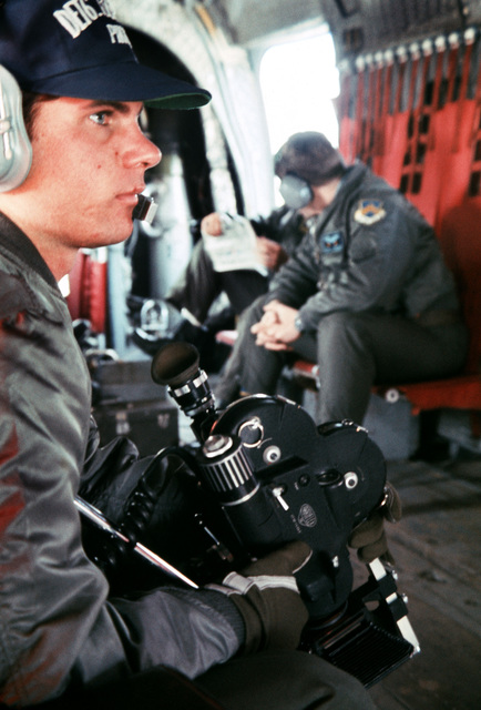 AIRMAN First Class Bill Lindsey of Detachment 6, 1369th PHOTO Squadron, provides motion picture coverage of activities taking place during exercise TEAM SPIRIT '77