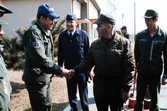 General John W. Vessey Jr., Commander of the United Nations Command and US Forces, Korea, meets members of the 18th Tactical Fighter Wing who are participating in exercise TEAM SPIRIT '77