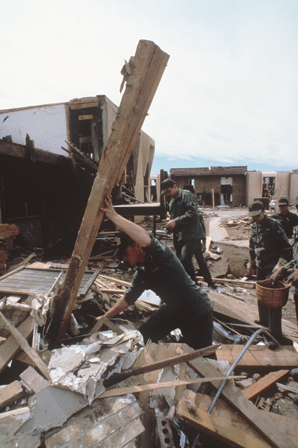 Members of the 3750th Civil Engineering Squadron from Sheppard Air Force Base search for survivors in the rubble of an apartment building destroyed by a tornado