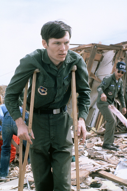 STAFF Sergeant Joseph Patterson, a member of the 3750th Consolidated Maintenance Squadron at Sheppard Air Force Base, surveys the wreckage of his home after it was destroyed by a tornado