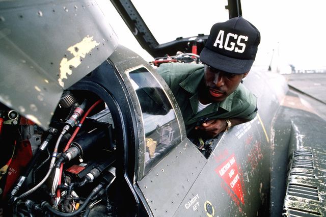 AIRMAN 1ST Class Marvin Jackson repairs navigation system components of an F-4E Phantom II aircraft during US Southern Command canal defense exercise Black Fury II. Units of the Army, Navy and Air Force are taking part in the exercise. This shot takes place at Howard Air Force Base, Canal Zone