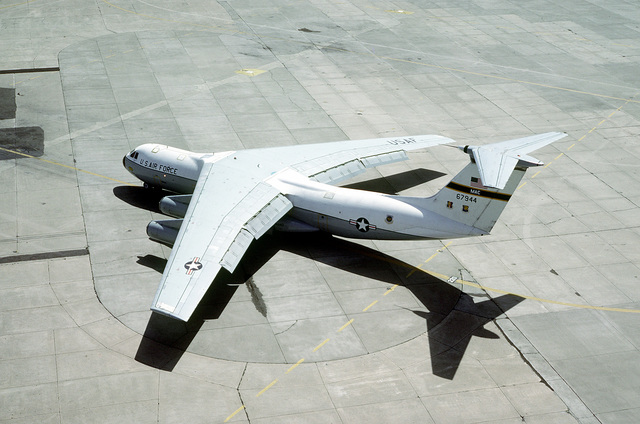 An elevated view of a Military Airlift Command C-141 Starlifter aircraft parked on the flightline