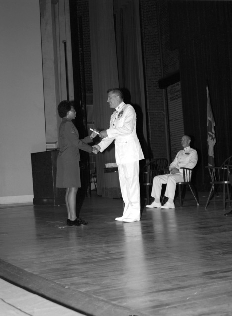 CPL Sharrion D. Bradford receives her diploma from BGEN William Weise, director of operations, Headquarters Marine Corps, during graduation exercises at the Marine Security Guard School, Marine Corps Development and Education Command