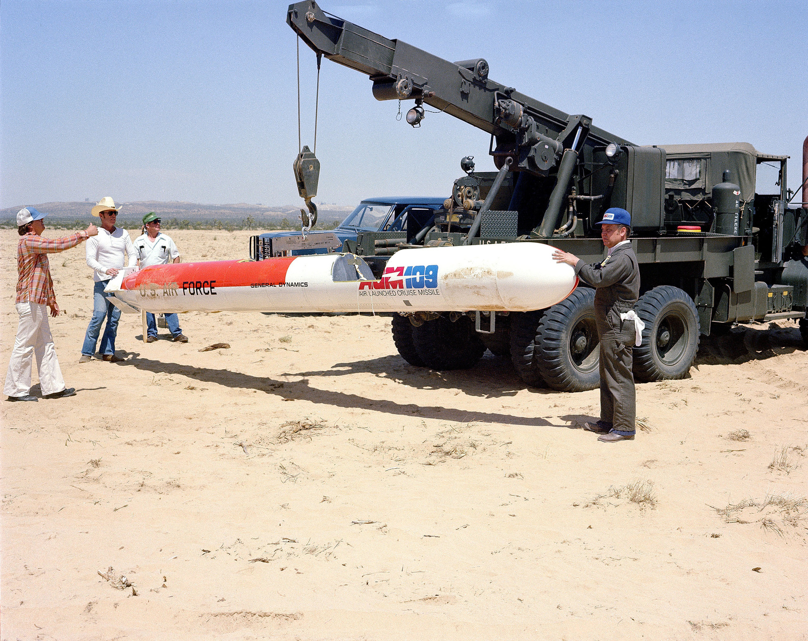 A crew uses a wrecker truck to lift an AGM-109 Tomahawk air