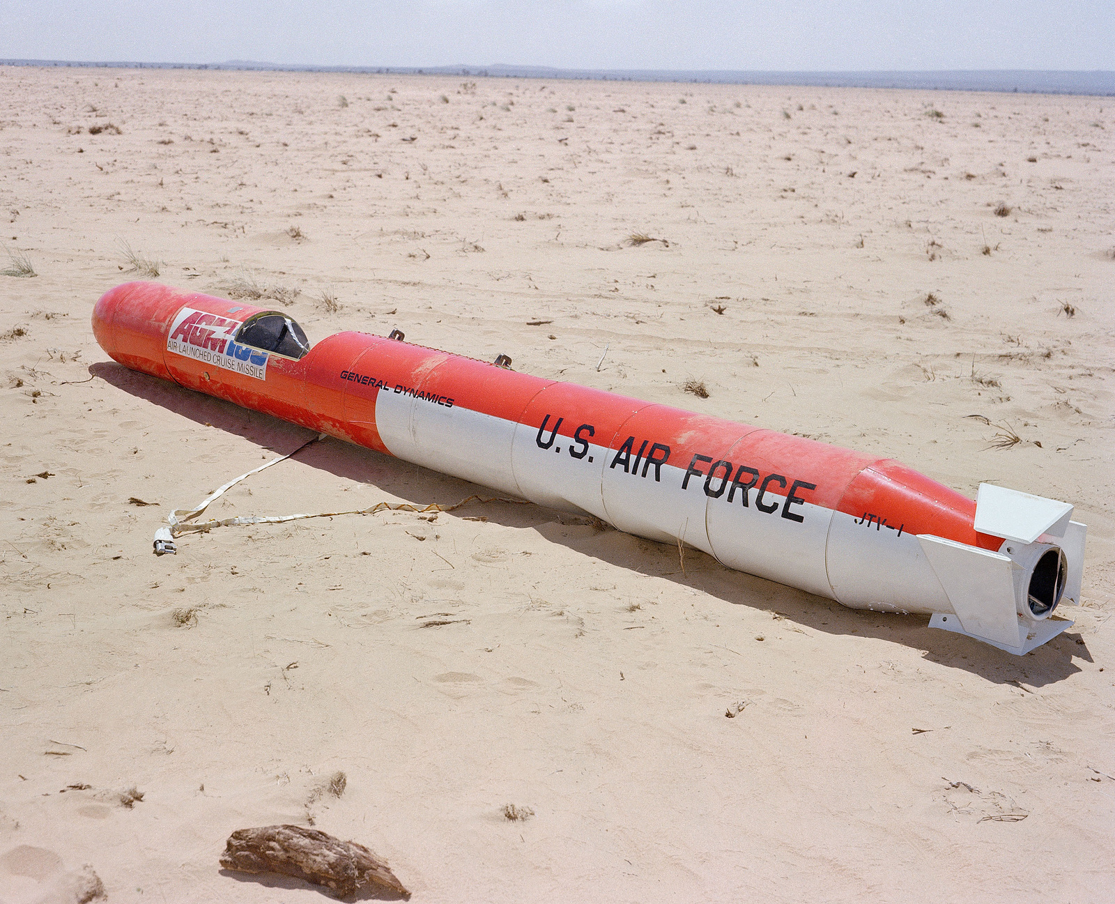 A rear view of an AGM-109 Tomahawk air-launched cruise missile on the ground after the impact