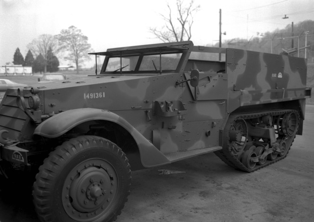 Marine Corps Development and Education Command, Quantico, Va....A Marine Corps personnel carrier, half track (M3), viewed from the left front with camouflage paint and without the canvas top