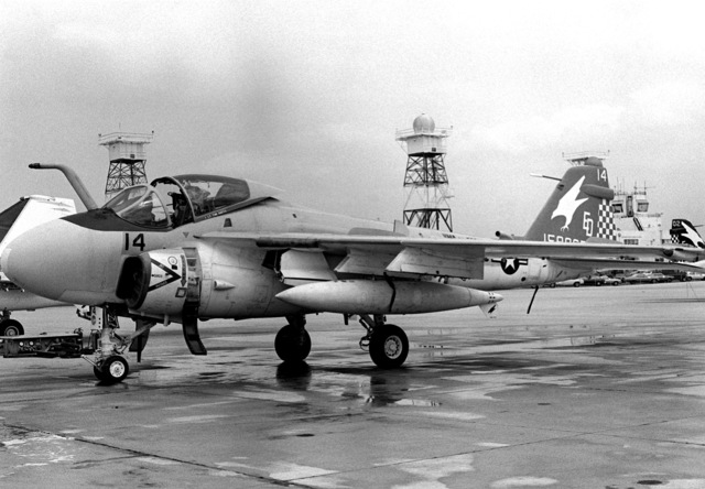 Left front view of a Marine A-6E Intruder aircraft sitting on the flight line of Marine All-Weather Medium Attack Squadron 533