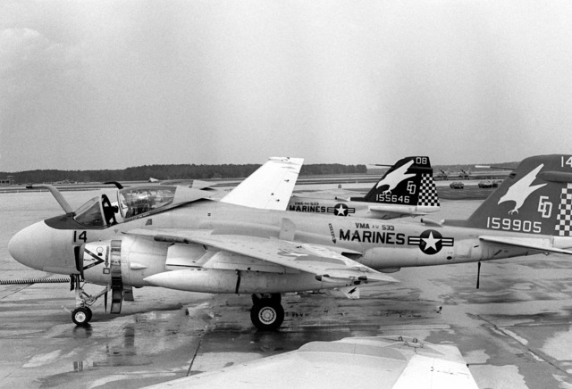 Left side view of a Marine A-6E Intruder aircraft sitting on the flight line of Marine All-Weather Medium Attack Squadron 533