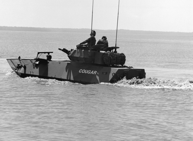 A Canadian armored vehicle general purpose (AVGP) Cougar demonstrates its amphibious abilities in the Potomac River. The Cougar is one of two AVGP being demonstrated before an audience of more than 100 Marines and civilians