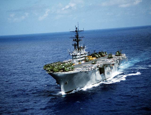 A port bow view of the amphibious assault ship USS IWO JIMA (LPH-2) underway to New York City for a Bob Hope show. The ship and crew has just completed a field exercise in Puerto Rico