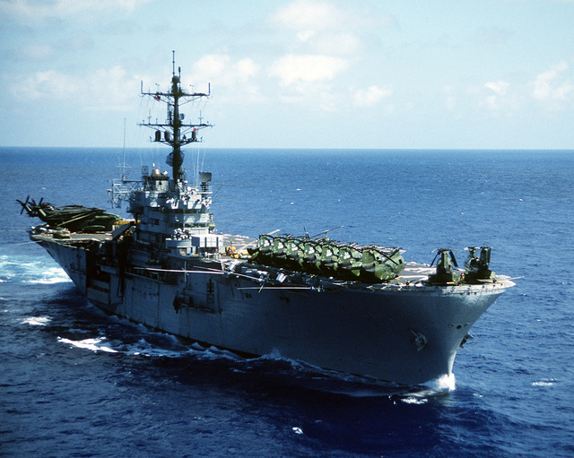 A starboard bow view of the amphibious assault ship USS IWO JIMA (LPH-2) underway to New York City for a Bob Hope show. The ship and crew has just completed a field exercise in Puerto Rico