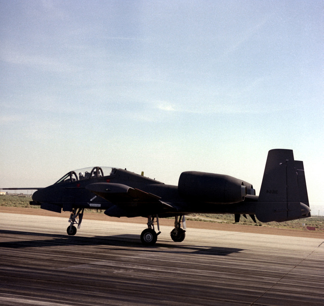 Left side view of an A-10 Thunderbolt II aircraft landing on the runway during a two-seat evaluation