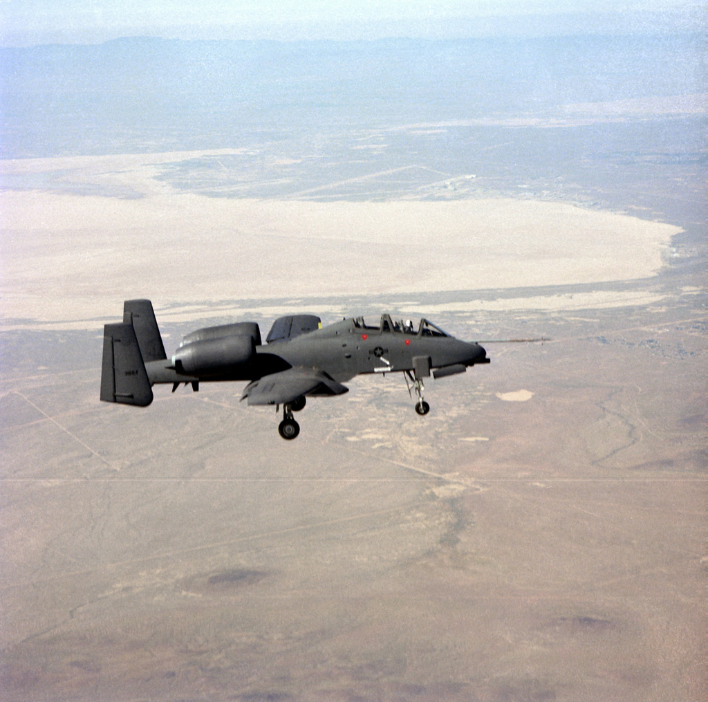 Right side view of an A-10 Thunderbolt II aircraft with landing gear down during a two-seat evaluation flight near Rogers Lake