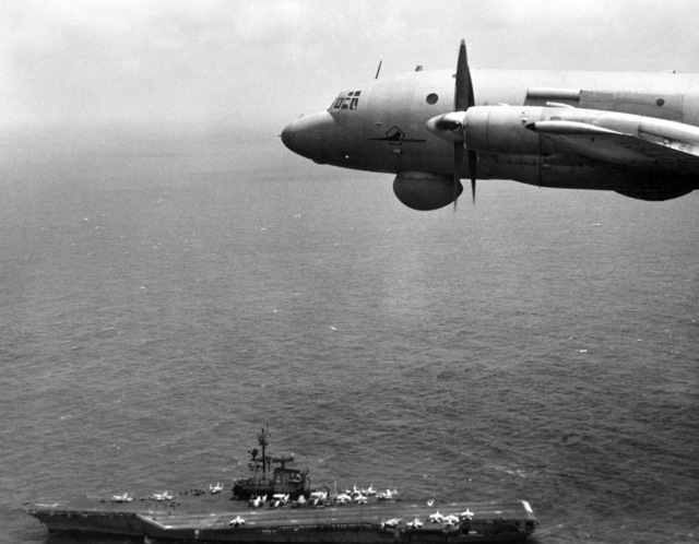 An air-to-air left side view of a Soviet I1-38 May reconnaissance and anti-submarine warfare aircraft over the aircraft carrier USS MIDWAY (CV 41)