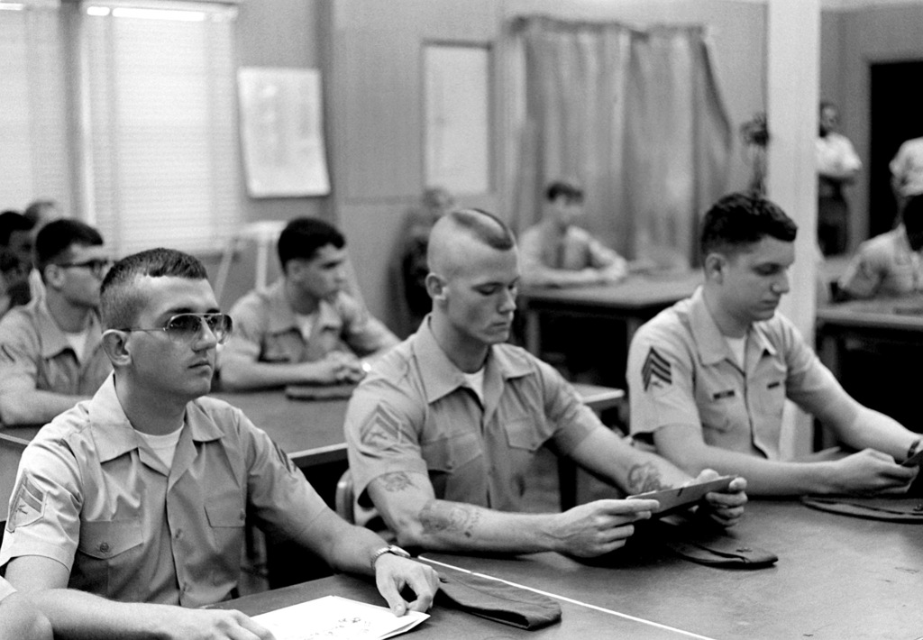 Marines are given a class on nuclear, biological and chemical defense. Three of the Marines in the front row are (l to r) CPLs Mark Harrington, William Hickes and SGT Michael Ayle