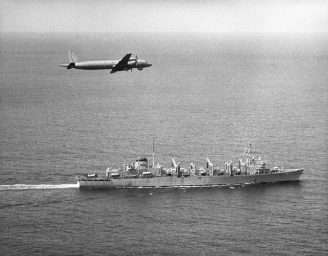 An air-to-air right side view of a Soviet I1-38 May reconnaissance and anti-submarine warfare aircraft over the fast combat support ship USS CAMDEN (AOE 2)