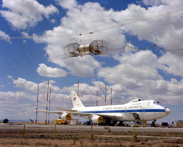 A right front view of an E-4 advanced airborne command post (AABNCP) on the electromagnetic pulse (EMP) simulator for the testing