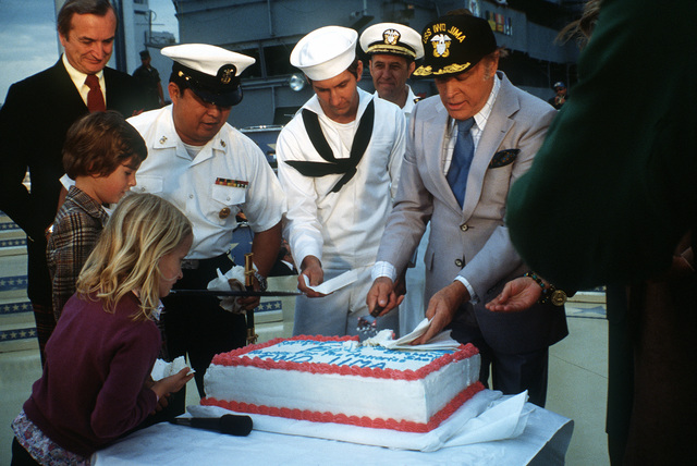 After the Bob Hope show aboard the amphibious assault ship USS IWO JIMA (LPH-2), Bob Hope is honored with a cake for his 76th birthday