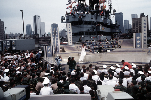 During the Bob Hope show aboard the amphibious assault ship USS IWO JIMA (LPH-2), singer and actress Diane Carroll sings to the Navy and Marine personnel of the ship