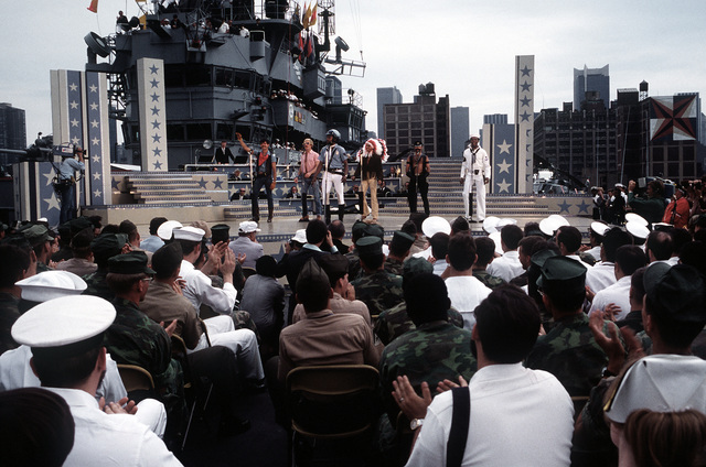 """During the Bob Hope show aboard the amphibious assault ship USS IWO JIMA (LPH-2), the """"Village People"""" singing group sings """"YMCA"""". The ship and crew have just completed a field exercise in Puerto Rico"""