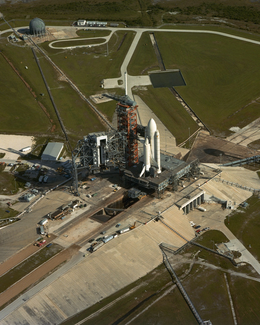 An aerial view of Space Launch Complex 39-A. A space shuttle orbiter and its booster rockets are in place on the pad