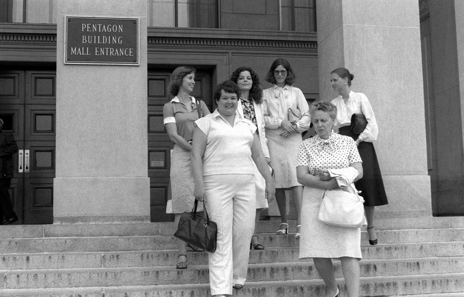 Six lovely and reasonable ladies, is how the members of Congress described the ladies who filed a petition to keep the Quantico hospital at the Marine Corps Development and Education Command open for services. The ladies, military wives, leave the Pentagon after filing their petition. The ladies, left to right, are : Louise Cruz, Sharon Heberlein, Nancy Fournier, Dianna Breuss, Anita Bonomo and Janet Schenkel
