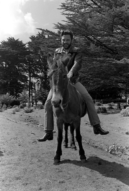 A crewman from the Unitas XX task force rides a burro at a party held during the exercise