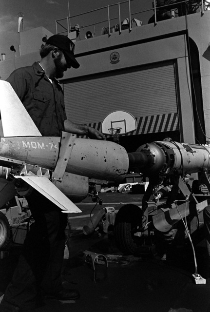 A crewman prepares to place the tail section onto the body of a drone before its launching from the deck of the frigate USS JESSE L. BROWN (FF-1089) during exercise Unitas XX