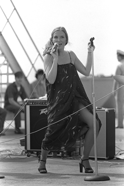 A female singer performs for crewmen as exercise Unitas XX gets underway
