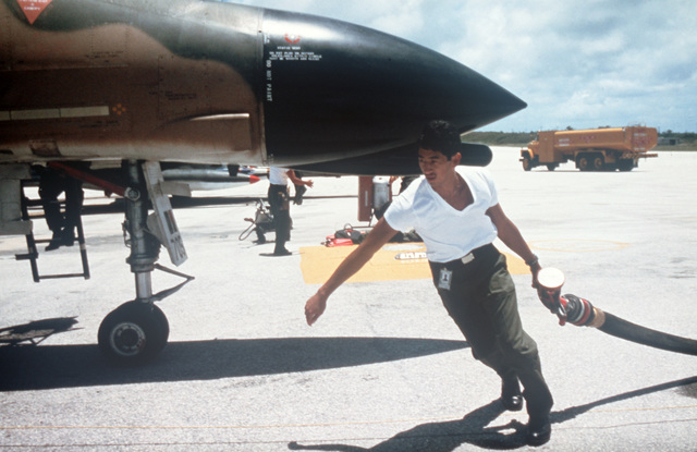 A ground crewman prepares to refuel a Hawaii Air National Guard F-4C Phantom II aircraft