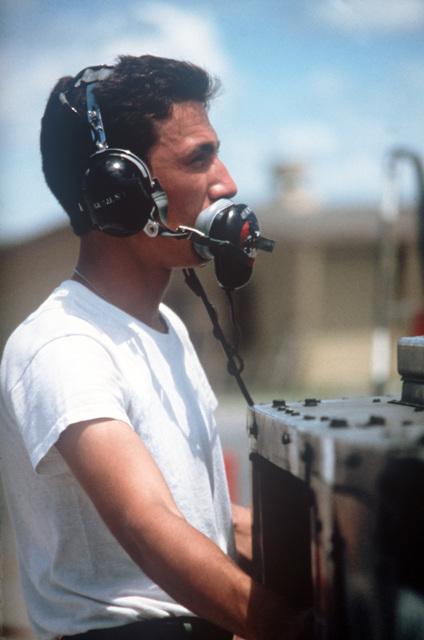 A Hawaii Air National Guard ground crewman prepares an aircraft for take off