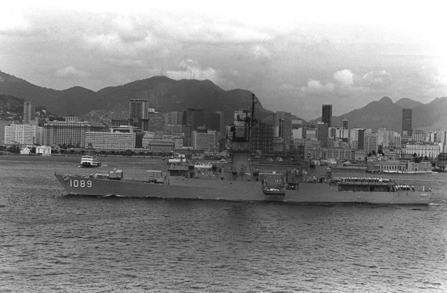 A port beam view of the frigate USS JESSE L. BROWN (FF-1089) with the city skyline in the background during exercise Unitas XX