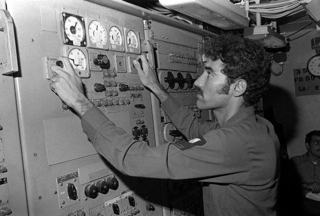 An interior communications electrician (IC) adjusts meter levels aboard his ship during exercise Unitas XX