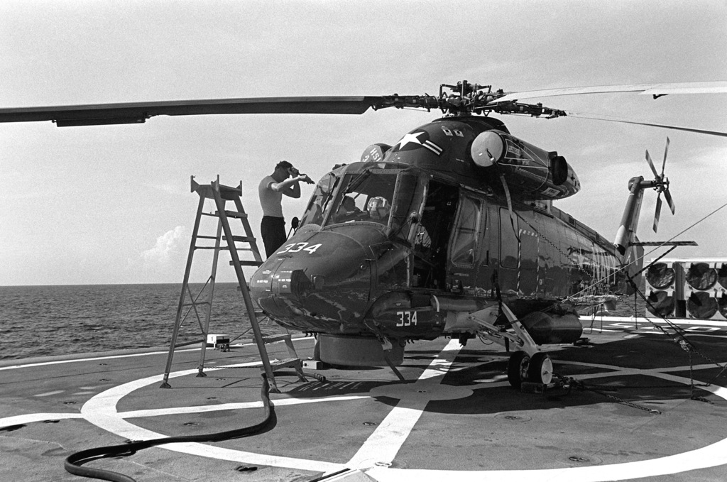 An SH-2D Seasprite helicopter on the flight deck of the frigate USS TRIPPE (FF-1075) during exercise Unitas XX