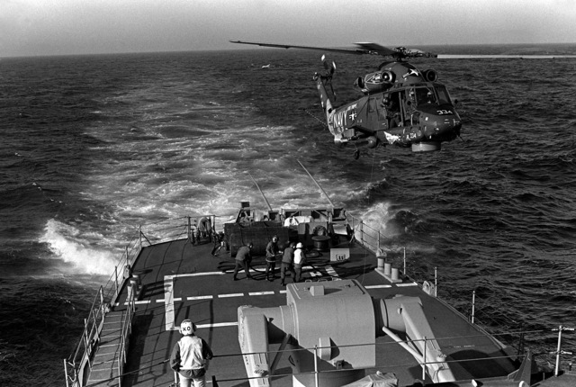 An SH-2F Seasprite light airborne multi-purpose system (LAMPS) helicopter hovers above the deck of a replenishment ship while refueling during exercise Unitas XX. The helicopter is assigned to Light Helicopter Anti-submarine Squadron 36 (HSL-36)