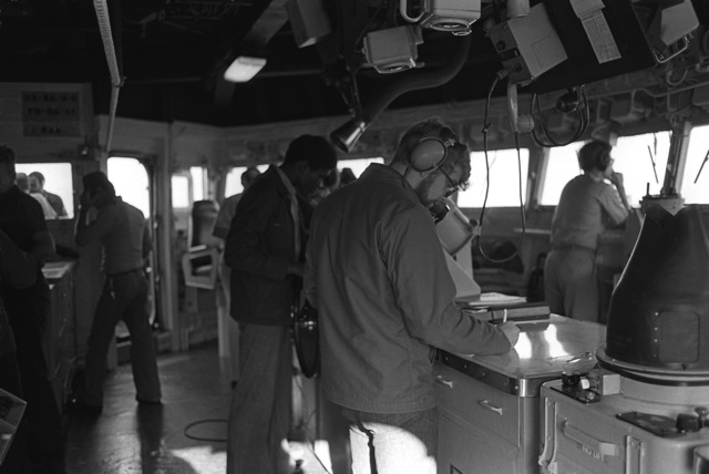 Crewmen in the pilot house of the guided missile destroyer USS DEWEY (DDG-45) perform assigned duties during exercise Unitas XX
