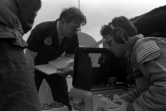 Crewmen prepare the remote controls for drones before their launching from the deck of the frigate USS JESSE L. BROWN (FF-1089) during exercise Unitas XX